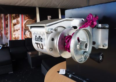 TU auto-tensioner with chain type spool and chassis mount for log trailers